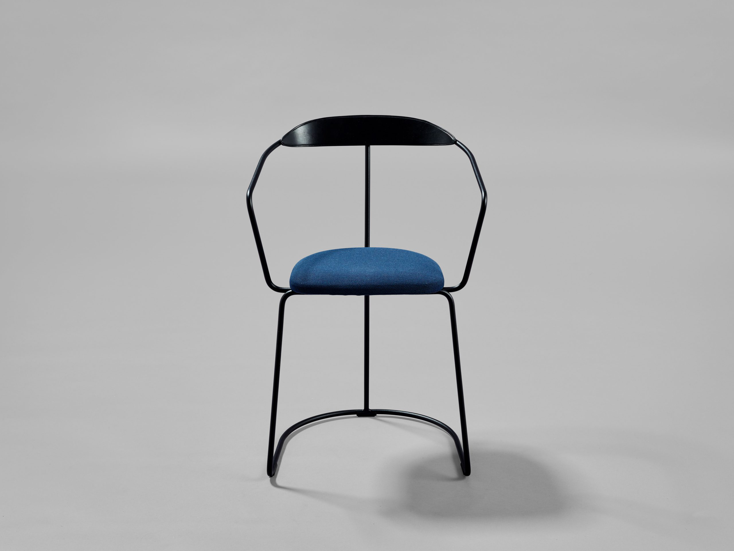 https://www.minustio.se/wp-content/uploads/2021/03/Ghost-chair-450mm-black-upholstered-blue-fabric_web-scaled.jpg